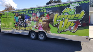 Level Up Game Truck outside daytime, with video game characters on the side.