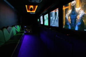 Inside of Game Truck Rental, Orange Lighting Blue Floors