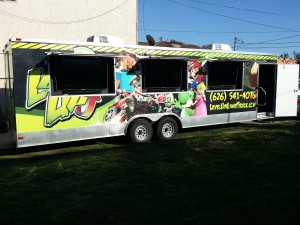 Level Up Game Truck showing exterior large HDTVs out and door open